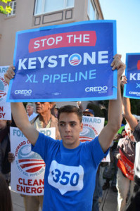Protester holds a 'Stop the Keystone XL Pipeline' sign